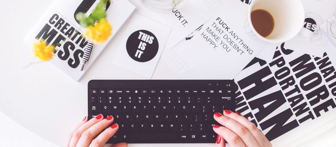 girl-writing-on-a-black-keyboard-6469